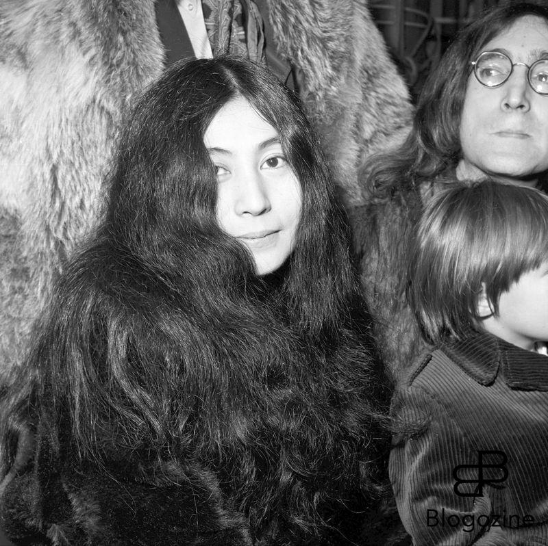Yoko Ono , japanese actress , John Lennon in background Ref: PGH170789 Date: 10.12.1968 COMPULSORY CREDIT: Starstock/Photoshot 9th November 1966 - John Lennon and Yoko Ono meet for the first time at her exhibition at the Indica Gallery in London. Lennon remembered the date of their meeting as the 9th but many Beatles historians contend that it actually happened on the 7th, the day before the exhibition opened.