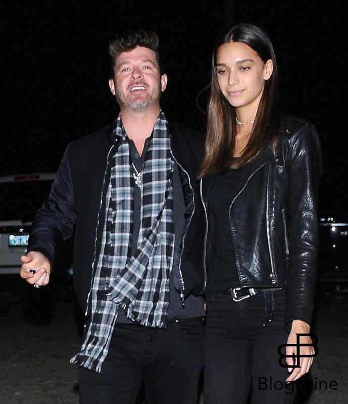 52219969 Singer Robin Thicke and his girlfriend April Love Geary were spotted arriving out of costume to a Halloween party in Los Angeles, California on October 31, 2016. FameFlynet, Inc - Beverly Hills, CA, USA - +1 (310) 505-9876