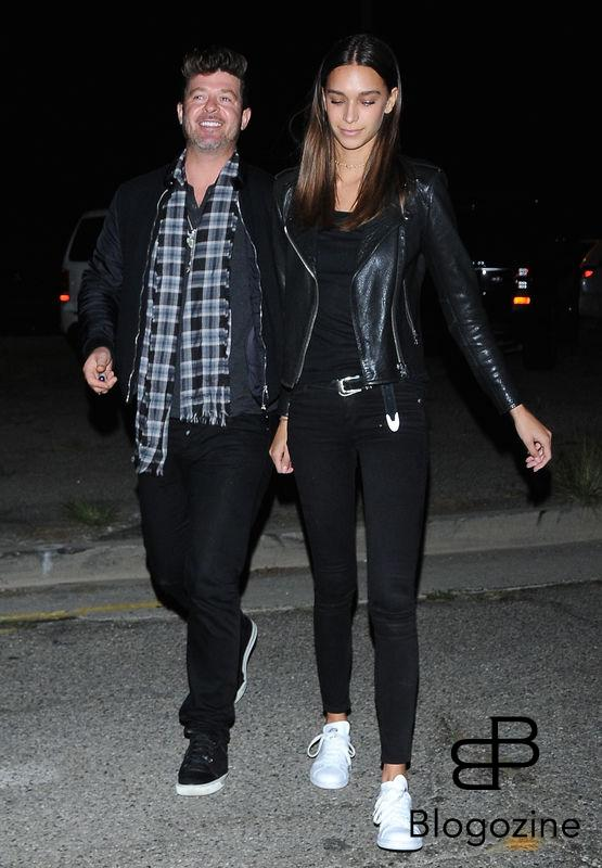 52219971 Singer Robin Thicke and his girlfriend April Love Geary were spotted arriving out of costume to a Halloween party in Los Angeles, California on October 31, 2016. FameFlynet, Inc - Beverly Hills, CA, USA - +1 (310) 505-9876